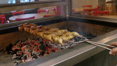 man is grilling chicken on the grill in a fast food restaurant Footage