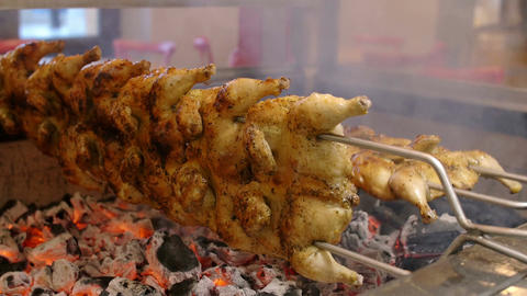Cook the chicken on the grill over hot coals Footage