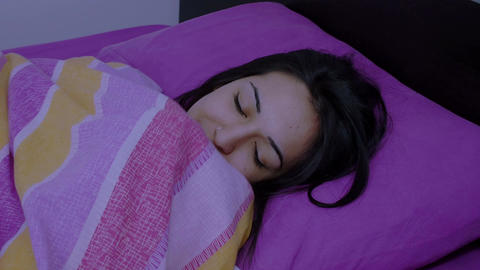 woman sleeping on the night in her bed Footage