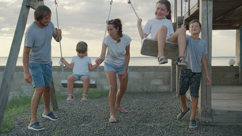 Happy family on a swing at sun light. Happy family concept Live Action