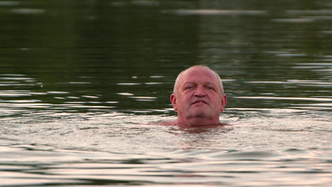 26-21-1-X- A Man Swims And Rests On The Lake.