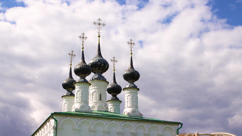 Five black domes with golden crosses against the sky Live Action