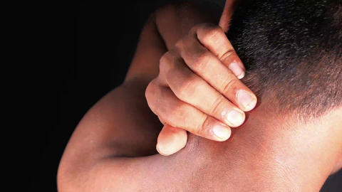 man suffering from neck or shoulder pain at home Live Action