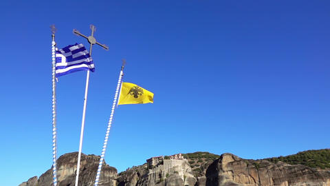 Flags in Greek Meteora. Slow Motion Live Action