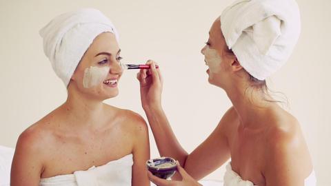 Beautiful woman having a facial treatment at spa Live Action