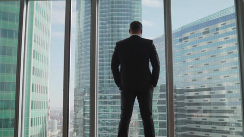 Hard times for a businessman and his business. Thoughtful businessman portrait Live Action