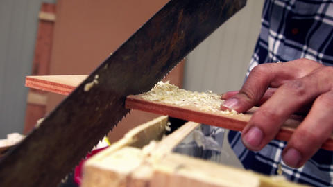 Carpenter working on wood craft at workshop Live Action