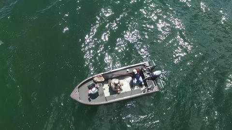 Drone Shot of Men Fishing In A Boat From Above Live Action