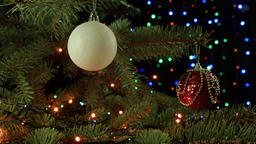 Christmas decoration balls hanging on Christmas tree on the background lights ga Footage