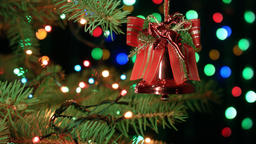 Christmas bell on Christmas tree with blurred lights garlands, fairy background Footage