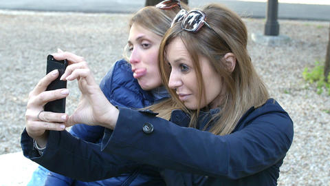 friends making a selfie: taking pictures with a smartphone Footage