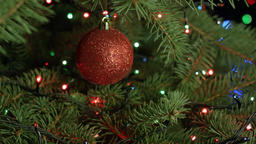 Christmas tree decoration red ball on a background garlands Footage