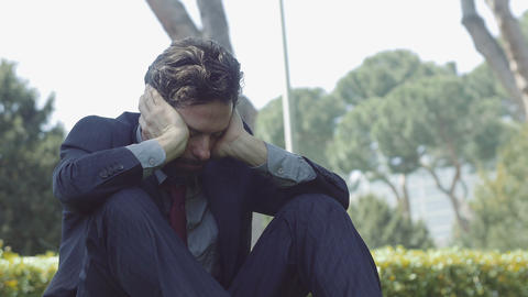 depressed and sad businessman: worried and lonely businessman Footage