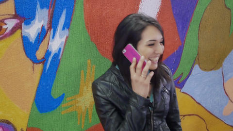 very happy woman having a phone call: cute woman talking with a friend Footage