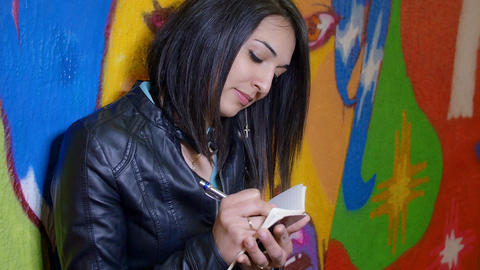 young woman taking notes: notepad, pencil, pen, student, journalist Footage