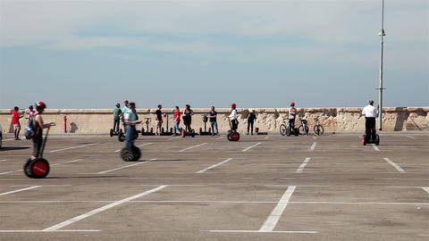 Tel - Aviv, Israel – October 26, 2016: People ride on segway along the coast Footage