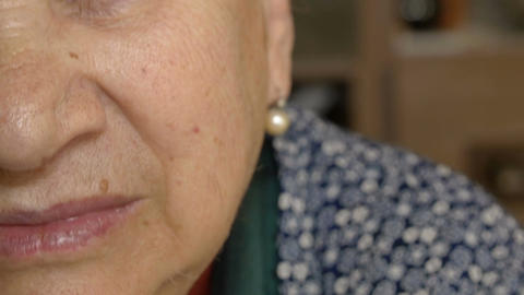 old woman portrait of half face: closeup footage on old wrinkled woman Footage