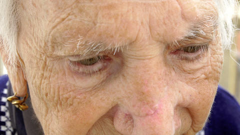 grandmother portrait focused on her eyes; wrinkled, retired, elderly Footage