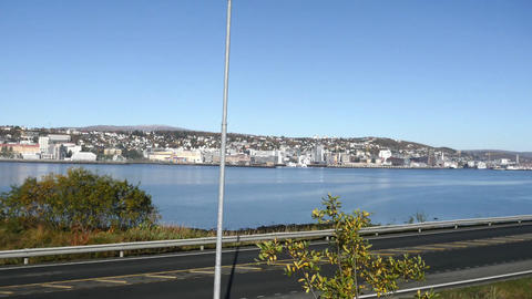 Pan view on a road in front of the city of Tromso, in north Norway Live Action
