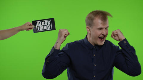 Inscription Black Friday appears next to smiling man. Guy celebrating, smiling Live Action