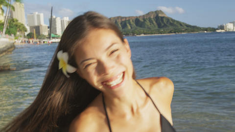 Beach woman smiling laughing having fun in bikini Live Action