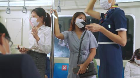 Crowd of people wearing face mask on a crowded public subway train travel Live Action