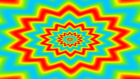 Animated red yellow and blue spiky shape like flower shape turning around the middle. Geometrict Live Action