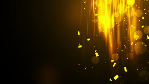 Falling shiny golden confetti. Bright festive tinsel of gold color. Bokeh lights on black Animation