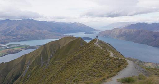 New Zealand hiking people on mountain top Roys Peak enjoying active lifestyle Live Action
