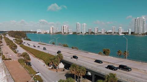 Traffic over Rickenbacker Causeway in Miami, slow motion aerial view. Slow Live Action