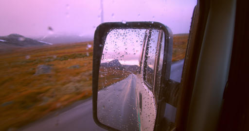 Reflection in camping van mirror on road trip Live Action