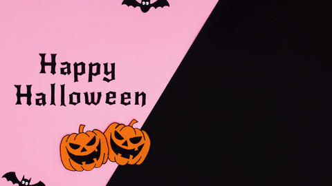 Happy Halloween text, pumpkins, bats and ghosts appear on pink black theme. Stop motion Animation