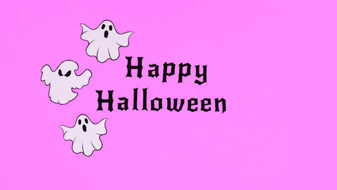 Ghosts fly around Happy Halloween text. Stop motion Animation