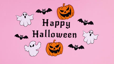 Pumpkins, ghosts and bats move around Happy Halloween text. Stop motion Animation