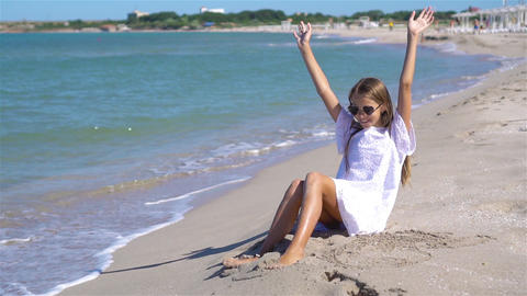Cute little girl at beach during summer vacation Live Action