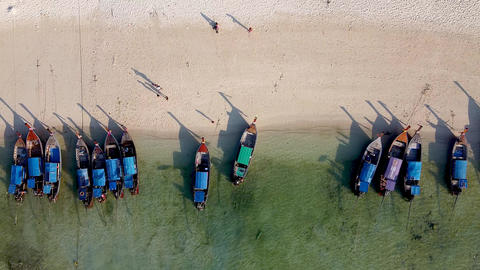 Amazing overhead aerial view of Long Tail Boats on a Thailand Beach Shoreline Live Action