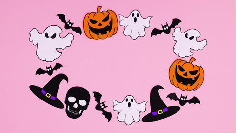 Halloween pumpkins, bats, ghosts, witch hat move in circle with empty space inside. Stop motion Animation