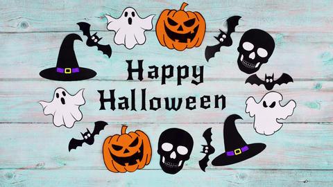Halloween stickers move around Happy Halloween text on wooden theme. Stop motion Animation