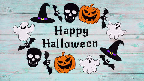 Halloween stickers move in circle around Happy Halloween text on wooden theme. Stop motion Animation