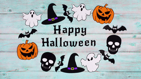 Happy Halloween text appear and Halloween stickers around text on wooden theme. Stop motion Animation