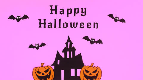 Bats fly above creepy house and happy Halloween text appear on purple theme. Stop motion Animation