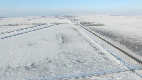 Snow Covered Roads Near Farm Fields In Rural America