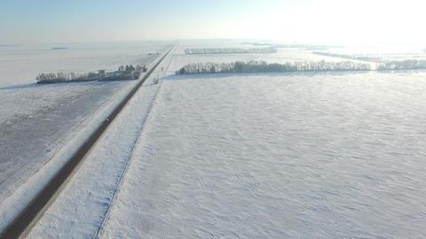 Snow Covered Roads Near Farm Fields In Rural America 0