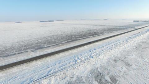 Snow Covered Roads Near Farm Fields In Rural America 1