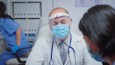 Close up of doctor speaking with mother Live Action