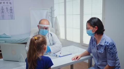 Doctor showing skeleton on tablet Live Action
