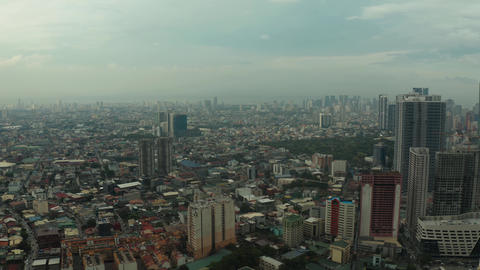 City of Manila, the capital of the Philippines with modern buildings. aerial Live Action