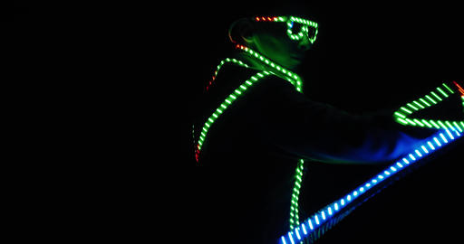 Glowing glasses and costume, a man is dancing with an LED stick in hand, 4k Live Action