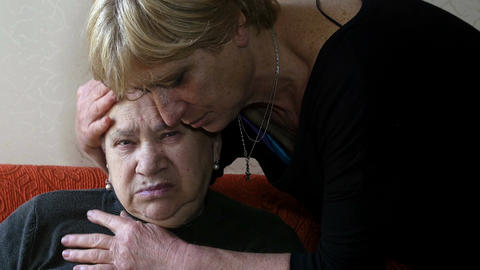 sad old woman comforted by her daughter Footage