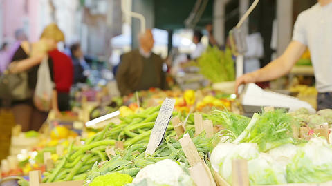 at the market place: stands selling vegetables Footage